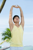 Healthy Asian Man doing yoga Royalty Free Stock Images