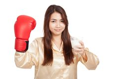 Healthy Asian woman with boxing glove and glass of milk Royalty Free Stock Image