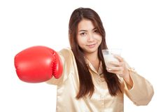 Healthy Asian woman with boxing glove and glass of milk Royalty Free Stock Images