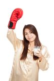 Healthy Asian woman with boxing glove and glass of milk Royalty Free Stock Photo