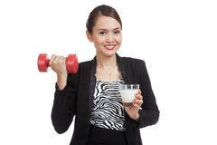 Healthy Asian woman drinking a glass of milk and dumbbell Royalty Free Stock Images