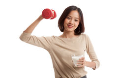 Healthy Asian woman drinking a glass of milk and dumbbell Royalty Free Stock Photo