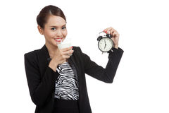 Healthy Asian woman drinking  glass of milk hold clock Royalty Free Stock Image