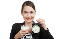 Healthy Asian woman drinking  glass of milk hold clock Royalty Free Stock Photo