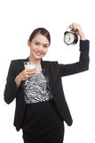 Healthy Asian woman drinking  glass of milk hold clock Royalty Free Stock Photography