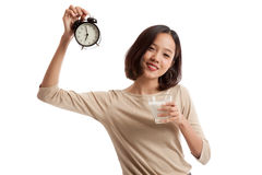 Healthy Asian woman drinking  glass of milk hold clock Royalty Free Stock Images