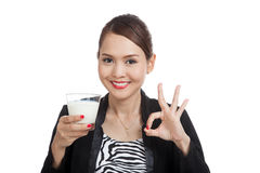 Healthy Asian woman drinking a glass of milk show OK sign Stock Photo