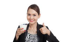 Healthy Asian woman drinking a glass of milk thumbs up Stock Photography