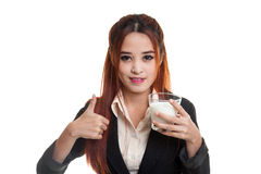 Healthy Asian woman drinking a glass of milk thumbs up. Stock Photos