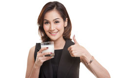 Healthy Asian woman drinking a glass of milk thumbs up. Stock Photography