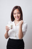 Healthy Asian woman drinking a glass of milk. Royalty Free Stock Photo
