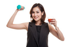 Healthy Asian woman with dumbbell and  tomato juice. Stock Photography