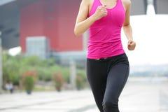 Healthy asian woman jogging at city Stock Photo