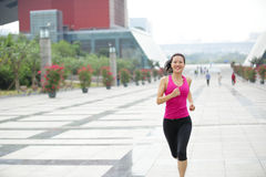 Healthy asian woman jogging at city Royalty Free Stock Photo