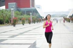 Healthy asian woman jogging at city Royalty Free Stock Photo