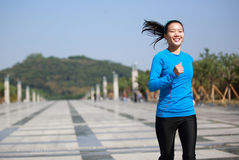Healthy asian woman jogging at city Royalty Free Stock Photos