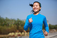 Healthy asian woman jogging at city Stock Photo