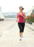 Healthy asian woman jogging at city Royalty Free Stock Photography