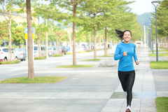 Healthy asian woman jogging Royalty Free Stock Photography