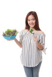 Healthy Asian woman with salad. Stock Photos