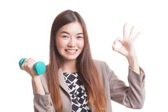 Healthy Asian woman show OK with dumbbells. Stock Photo