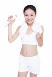 Healthy asian woman with towel and water bottle Stock Images
