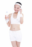 Healthy asian woman with towel and water bottle Royalty Free Stock Photos