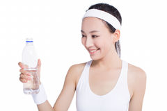 Healthy asian woman with towel and water bottle Stock Photos