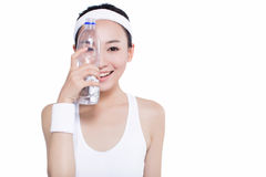 Healthy asian woman with towel and water bottle Royalty Free Stock Photography