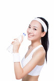 Healthy asian woman with towel and water bottle Royalty Free Stock Image