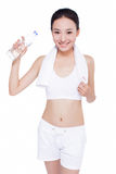 Healthy asian woman with towel and water bottle Stock Photography
