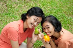 Healthy asian women loves fresh fruit Royalty Free Stock Photography