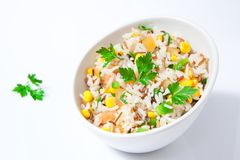 Rice salad on bowl. Healthy asorted rice salad on white bowl Stock Photo