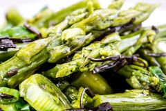 Healthy asparagus salad. Closeup of healthy delicious asparagus salad with spring onion and arame seaweed Royalty Free Stock Photos