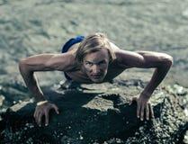 Healthy athlete doing push ups stock image
