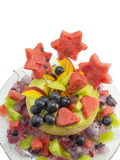 Healthy attractive fruit salad served in a fresh melon  on a gla Stock Photography