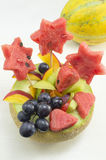 Healthy attractive fruit salad served in a fresh melon on white Stock Images