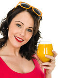 Healthy Attractive Young Woman With A Glass of Fresh Orange Juic Stock Photography