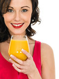 Healthy Attractive Young Woman With A Glass of Fresh Orange Juic Stock Photo