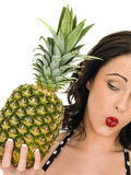 Healthy Attractive Young Woman Holding A Fresh Ripe Pinapple. Isolated Against a White Background Royalty Free Stock Photography