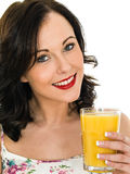 Healthy Attractive Young Woman Holding A Glass of Fresh Orange J Stock Photography