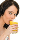 Healthy Attractive Young Woman Holding A Glass of Fresh Orange J Royalty Free Stock Photography