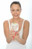 Healthy Attractive Young Woman Holding a Glass of Iced Water Stock Images