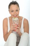 Healthy Attractive Young Woman Holding a Glass of Iced Water wit Royalty Free Stock Photos