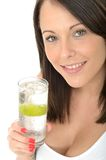 Healthy Attractive Young Woman Holding a Glass of Sparkling Water with Ice and Lime Royalty Free Stock Image