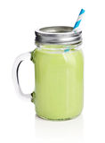 Healthy avocado green smoothie. With straw in a jar mug isolated on white Stock Photos