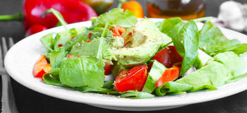 Healthy Avocado Salad with Spinach,Onion,Cucumber and Tomatoes Stock Image