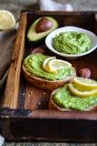 Avocado spread with garlic on wholewheat slice of bread. Healthy avocado spread with garlic on wholewheat slice of bread Royalty Free Stock Image