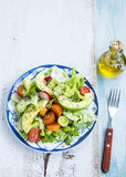 Healthy avocado and vegetables salad with radish,onions,lettuce Stock Photos