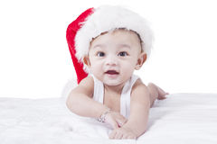 Healthy baby with Christmas hat Stock Image